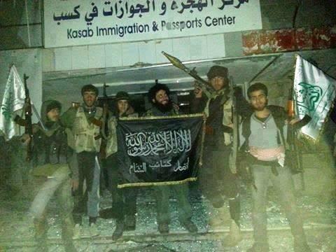 Turkey-sponsored-jihadis-pose-with-Islamic-flag-in-conquered-Christian-Armenian-town-of-Kessab